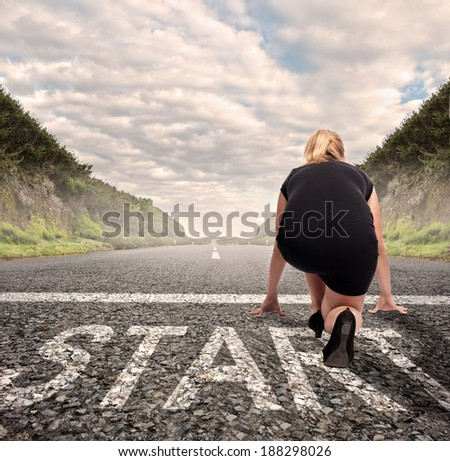 businesswoman on a road ready to run. Motivation concept - stock photo