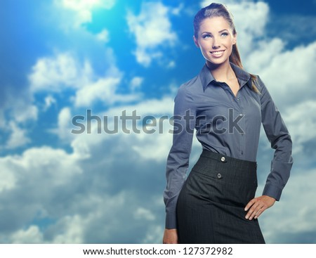 Businesswoman on Blue sky background