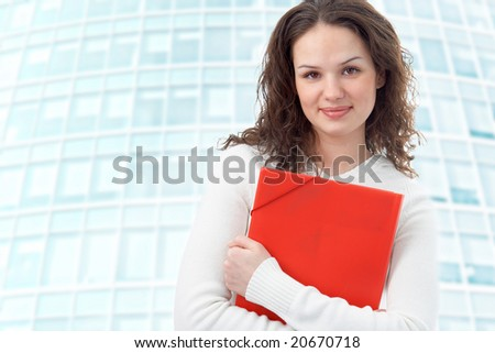 businesswoman on modern glass building background