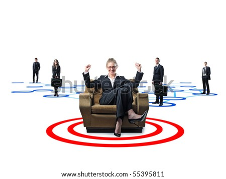 businesswoman on sofa and her working team - stock photo