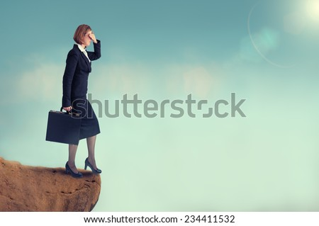 businesswoman on the edge of a cliff  - stock photo