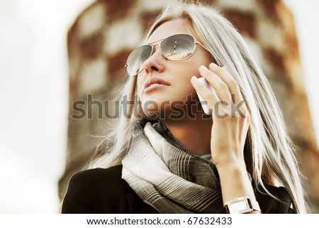 Businesswoman on the phone against industrial background. - stock photo