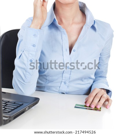 Businesswoman on workplace with credit card in hand - stock photo