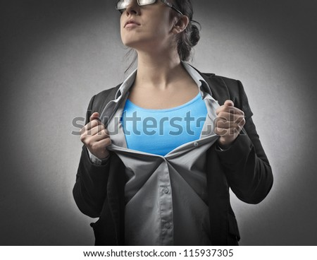 Businesswoman opening his shirt like a superhero
