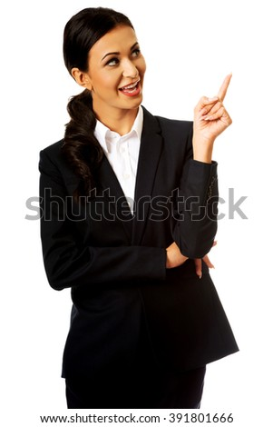 Businesswoman pointing at copyspace - stock photo