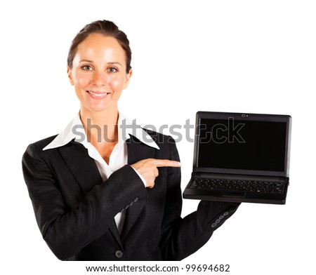 businesswoman pointing at laptop screen - stock photo