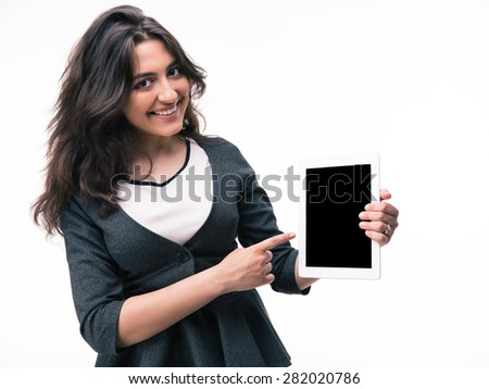 Businesswoman pointing finger on tablet computer screen isolated on a white background. Looking at camera - stock photo