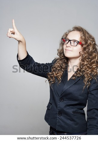 Businesswoman pointing on empty space over white background - stock photo