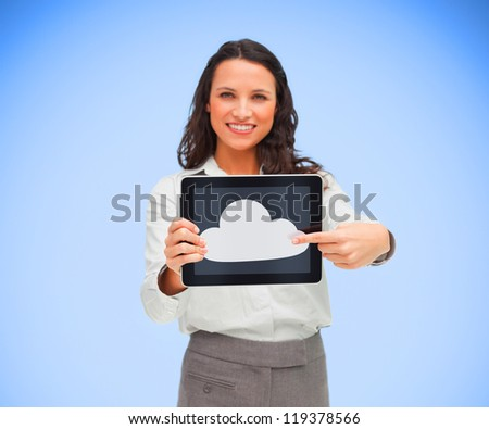 Businesswoman pointing to cloud computing symbol on tablet pc and smiling - stock photo