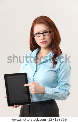 businesswoman pointing to the digital tablet - stock photo