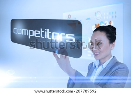 Businesswoman pointing to word competitors against technology interface - stock photo