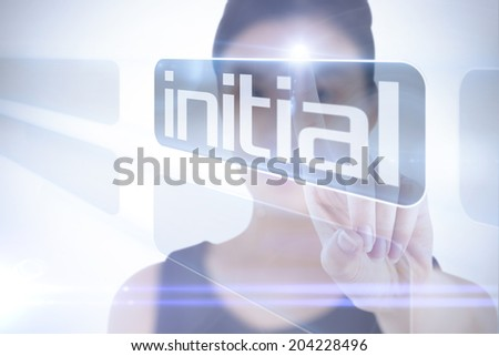 Businesswoman pointing to word initial against white background with vignette