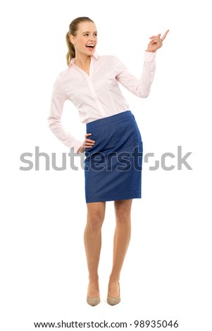 Businesswoman pointing up - stock photo