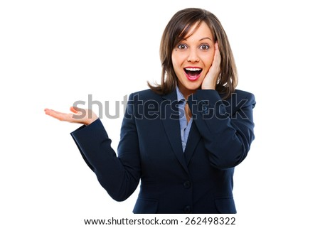 Businesswoman pointing with a hand and showing surprise isolated on white background - stock photo