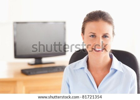 Businesswoman posing in her office looking at the camera