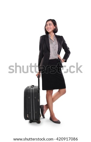 Businesswoman posing with black suitcase and looking sideways, full length shot on white studio background