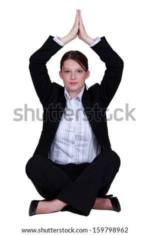 Businesswoman practicing yoga - stock photo