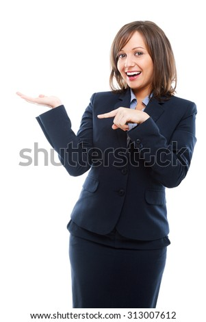 Businesswoman presenting an imaginary product and pointing with a finger. Isolated on white background