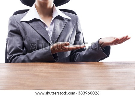 Businesswoman presenting and showing something at desk.