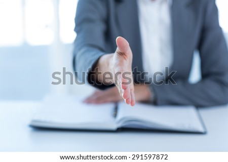 Businesswoman presenting her hand in the office