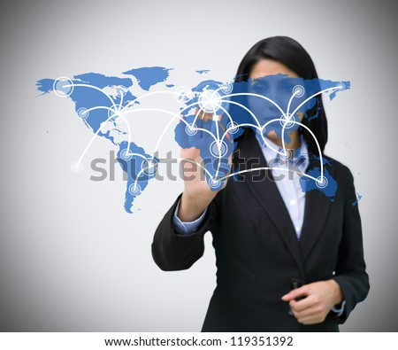 Businesswoman pressing blue world map hologram - stock photo