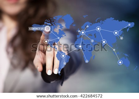 Businesswoman pressing contact us icon on world map.