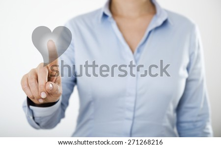 Businesswoman pressing heart icon button on the digital touch screen  - stock photo