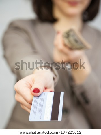 Businesswoman proposing plastic card, closeup shot - stock photo
