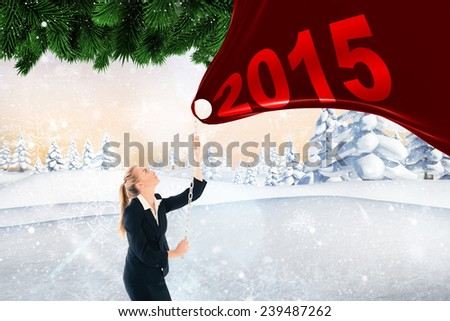 Businesswoman pulling a chain against christmas scene - stock photo