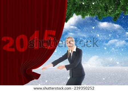 Businesswoman pulling a rope against christmas scene - stock photo