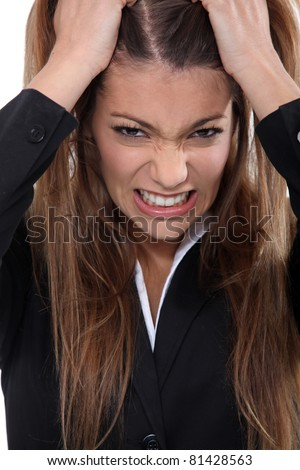 Businesswoman pulling hair out - stock photo
