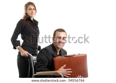 businesswoman pushing a businessman sitting in a wheelchair