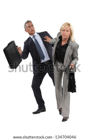 businesswoman pushing a colleague - stock photo