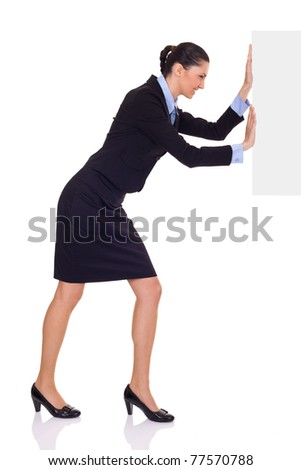 businesswoman pushing  big blank paper, full length, isolated on background - stock photo