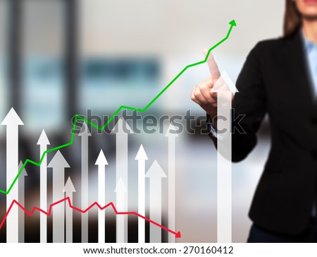 Businesswoman pushing the graph on visual screen. Women finger on growth line. Business stock, technology concept. Isolated on office. Stock Image - stock photo