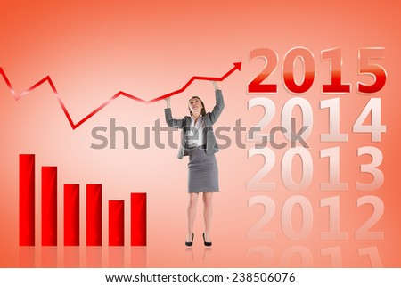 Businesswoman pushing up with hands against orange - stock photo