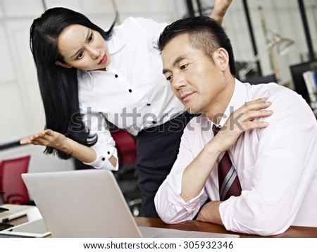 businesswoman puzzled and baffled by her male colleague's behavior. - stock photo