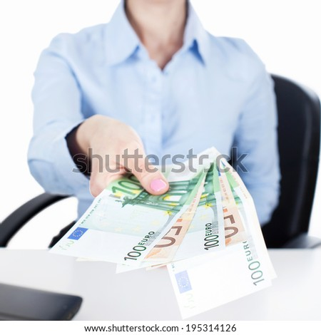 Businesswoman reach out euros in hand  - stock photo
