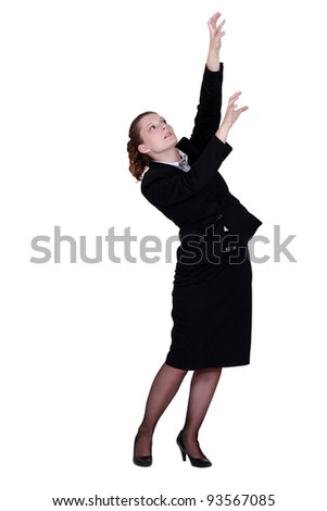 businesswoman reaching for archive boxes - stock photo