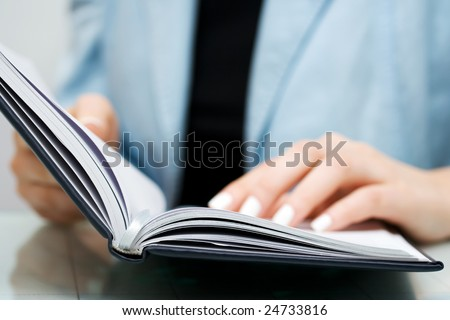 Businesswoman reading. - stock photo