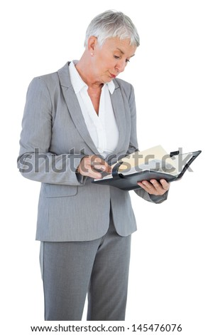 Businesswoman reading her diary on white background