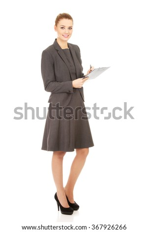 Businesswoman reading her notes.