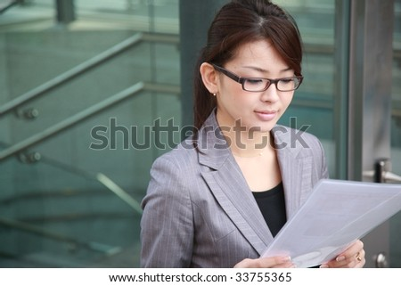 businesswoman reads documents