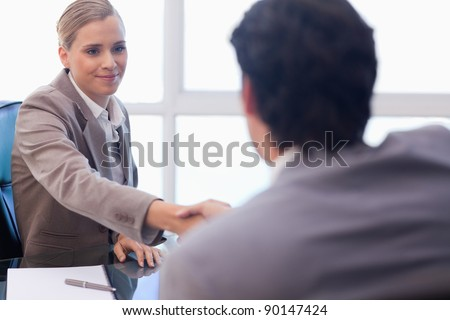 Businesswoman receiving a customer in her office