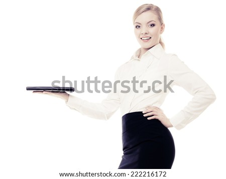 Businesswoman recommending your product. Elegant young woman showing blank copy space on hand isolated. Business advertisement.
