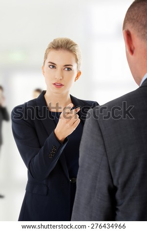 Businesswoman remprimended her business partner. - stock photo