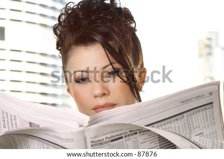 Businesswoman reviewing financial markets, stocks, money, business - stock photo