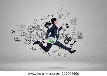 Businesswoman running to chase her target for success - stock photo