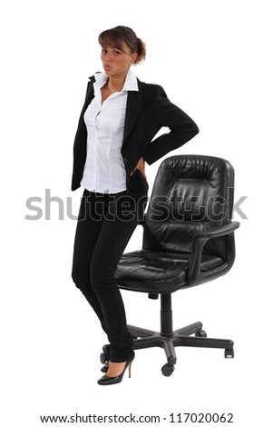 Businesswoman sat down for too long - stock photo