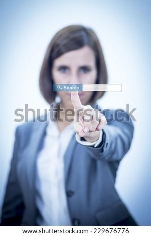 Businesswoman searching on internet virtual cloud - stock photo